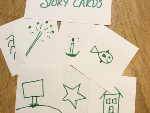 small white cards with simple drawings on them